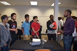 Students talk with an area professional about his career.