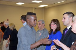 Students shakes hands with board member during recognition