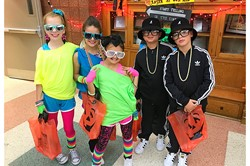 five students dressed for halloween