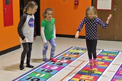 Students on numbers mat to learn math