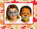 two kids with face painted like tigers