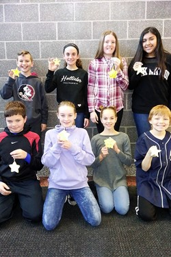 Students with ornaments they made