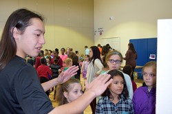 UEHS student talks with CFJ students.