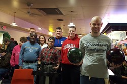 people posing before they bowl