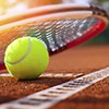 Tennis racket and ball on court.