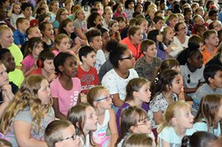 CFJ students listen to the Loud Librarians as they sing about the importance of reading during the summer.