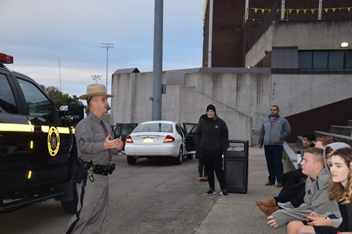 Trooper talking to students