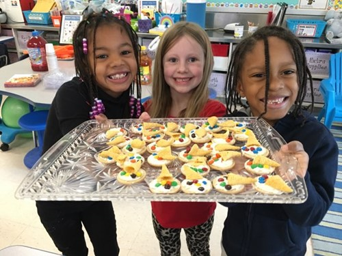 CFJ first grade students with cookies