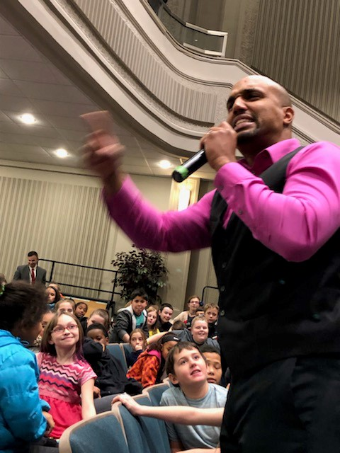 Arel Moodie speaks with students