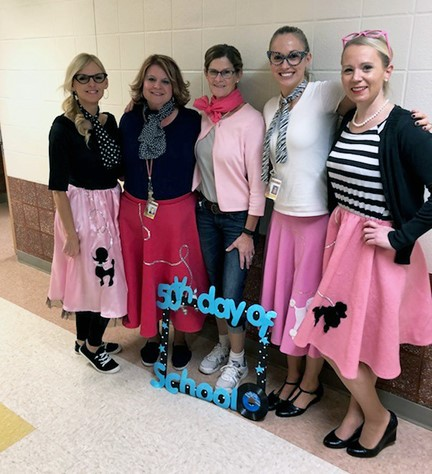 Staff dressed from the 50's.