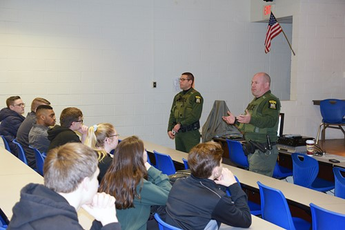 Officers talk with students