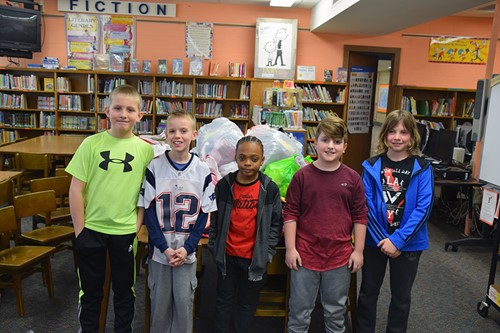 TJW students with donated clothing