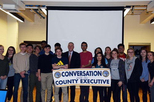 County executive Jason Garnar with students