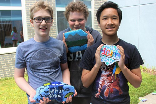 Students with painted rocks