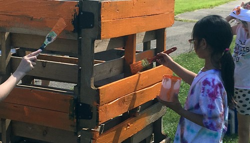 Students paint compost bin