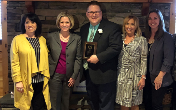 JFS principal Tim Lowie received the Region 9 Secondary Principal of the Year Award.