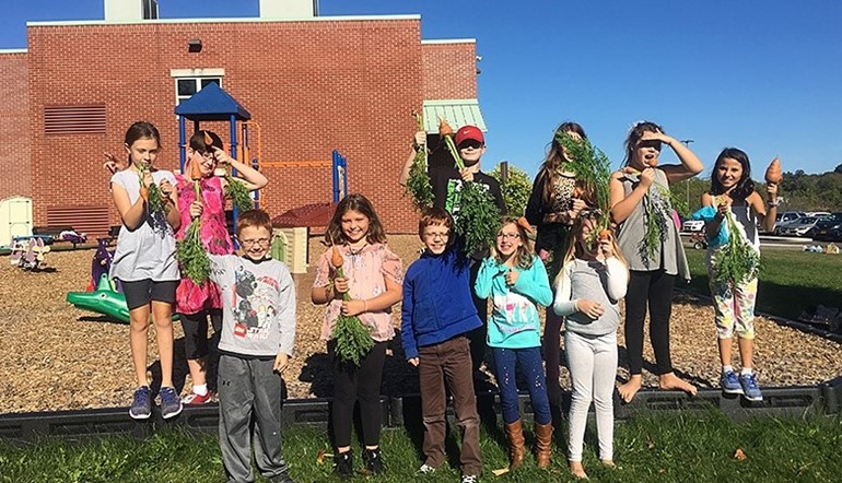 GFJ Garden Club with the vegetables they grew in their garden.