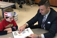 Students read to guests