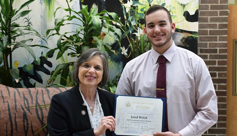 Assembly member Donna Lupardo presents a citation to Jared Welch.